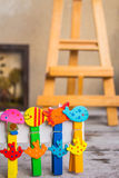 Colorful peg in a row Stock Images