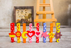 Colorful peg on wooden. Colorful peg in a row on the wooden royalty free stock photo
