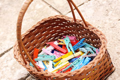 Colorful pegs. Colorful clothes pegs old and new in a wicker basket Stock Photos