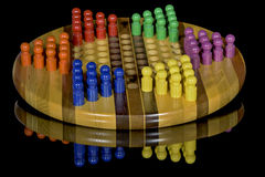 Colorful pegs in Chinese Checkers board Royalty Free Stock Image