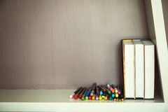 Colorful pen and books on shelve Stock Images