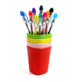 The colorful pen in colorful mugs. Stock Photography