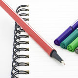 Colorful pen with notebook isolated on white Stock Photos