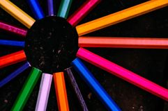 Colorful pencil around solid color. A circular pencil placed on a black background Stock Image