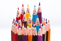 Colorful pencil as people smiling faces. Colorful pencil as smiling faces people. Image concept for social networking communication concept, rise from the crowd Stock Photography