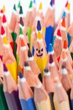 Colorful pencil as smiling faces stock images
