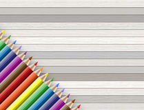 Colorful pencil with copy space isolated on wooden background Royalty Free Stock Photography
