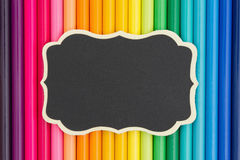 Colorful pencil crayon education background with a chalkboard Royalty Free Stock Photo