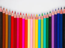 Colorful pencil crayons. Row of colorful pencil crayons against a white background background Stock Photos