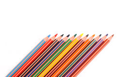 Colorful pencil crayons. On the background fabric Stock Photography