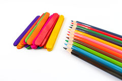 Colorful pencil crayons over a white background Royalty Free Stock Images