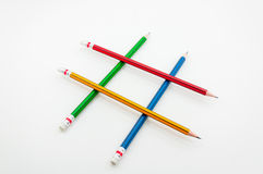 Colorful Pencil  in fist   power of written word on white Stock Image