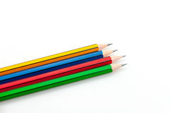 Colorful Pencil  in fist   power of written word on white Stock Images
