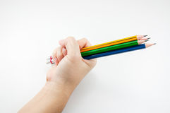 Colorful Pencil  in fist   power of written word on white Royalty Free Stock Image
