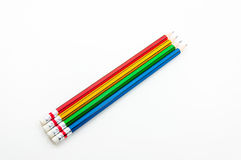 Colorful Pencil  in fist   power of written word on white Royalty Free Stock Photo