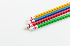 Colorful Pencil  in fist   power of written word on white Royalty Free Stock Photography