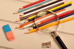 Colorful pencil with magnifying glass Royalty Free Stock Photography