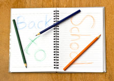 Colorful pencil and notebook.The text back to school Royalty Free Stock Images