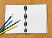 Colorful pencil and notebook Stock Photo