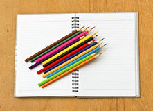 Colorful pencil and notebook Stock Image