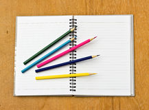 Colorful pencil and notebook Royalty Free Stock Photos