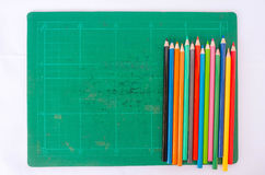 Colorful pencil on pad background Stock Photos