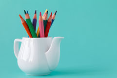 Colorful pencil set on table on blue background,  art and drawin. G, education and design, copy space Royalty Free Stock Images