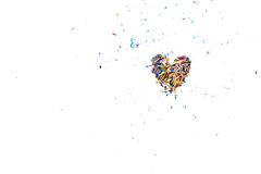 Colorful Pencil Shaving arrange to heart shape. On white desk Royalty Free Stock Photography