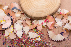 Colorful pencil shavings and  piece of wood Stock Photography