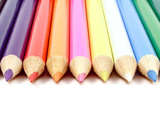 Colorful Pencils. Line of colorful pencils, isolated on a white background in vertical format. Copy space available on bottom half of photo royalty free stock images