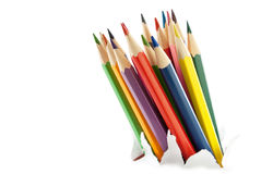 Colorful pencils. Colorful pencils breakthrough the white paper Royalty Free Stock Photo