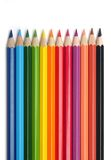 Colorful pencils. Row of vibrant colored pencils on white background Royalty Free Stock Image