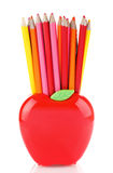 Colorful pencils in apple shaped stand Stock Photos