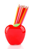 Colorful pencils in apple shaped stand Stock Photo