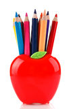 Colorful pencils in apple shaped stand Royalty Free Stock Images