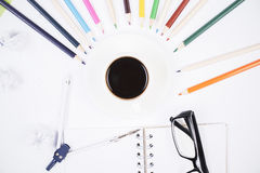 Colorful pencils around coffee cup Royalty Free Stock Image