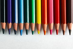 Colorful pencils arranged as a color pallete on paper Royalty Free Stock Image