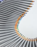 Colorful pencils arranged in a wave  over white  background Stock Photo
