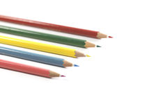 Colorful pencils arrangement. Clipboard, black board, caculator and pen isolated on white background Royalty Free Stock Photography