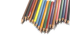 Colorful pencils arrangement. Clipboard, black board, caculator and pen isolated on white background Royalty Free Stock Photos