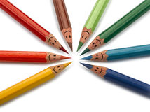 Colorful pencils as smiling faces people isolated Stock Images