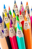 Colorful pencils as smiling faces. Stock Images