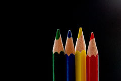 Colorful pencils before black Stock Photo