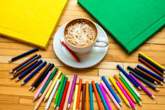 Colorful pencils with books and coffee Royalty Free Stock Photo