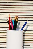 Colorful pencils and books pile Stock Photos