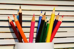 Colorful pencils and books Stock Image