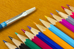 Colorful pencils and brush Royalty Free Stock Images