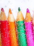 Colorful pencils and bubbles Royalty Free Stock Photos