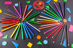 Colorful pencils in circles and geometric figures on the   chalkboard Stock Photo