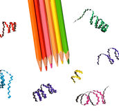 Colorful pencils and clippings. On white background Royalty Free Stock Images